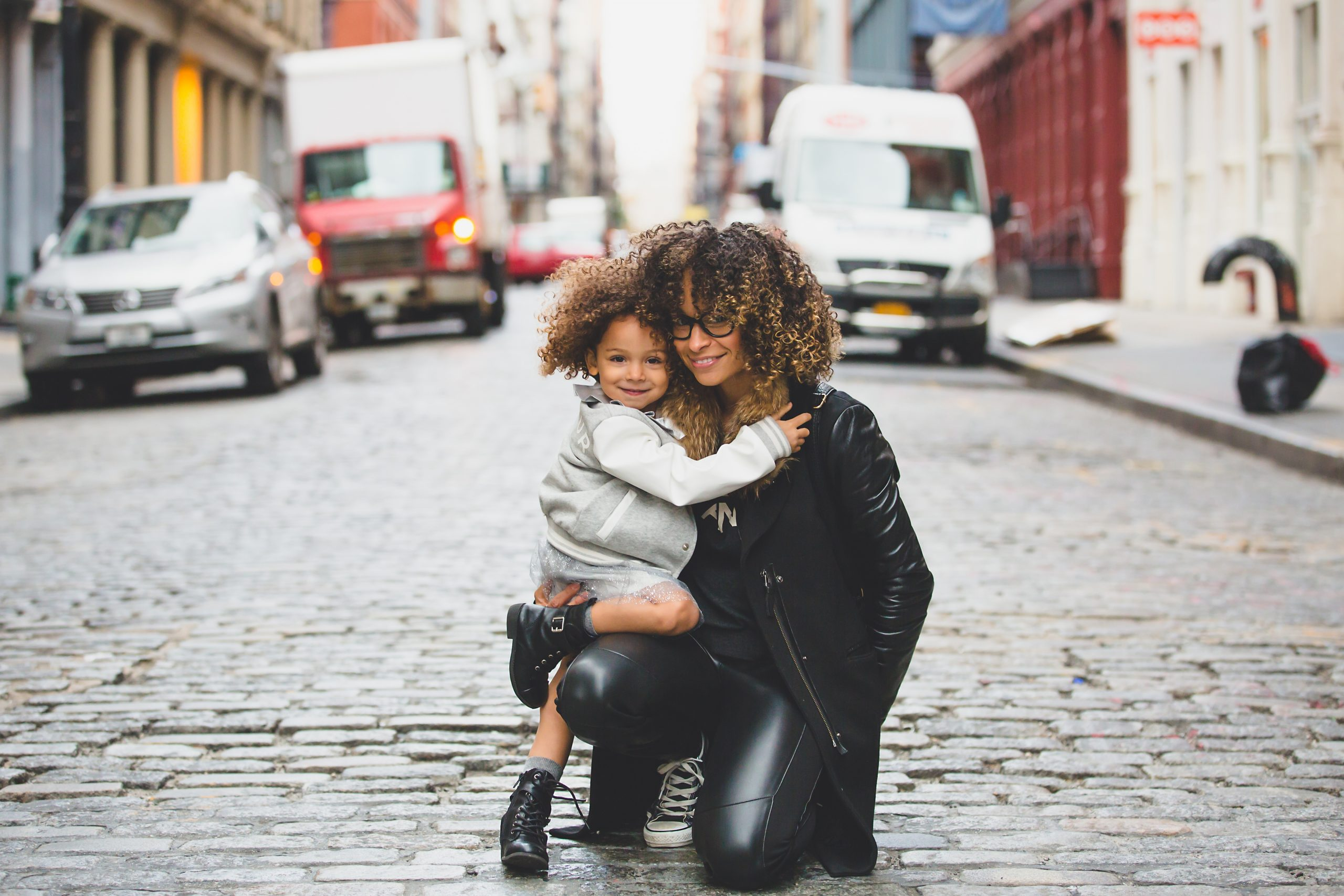Mother and child hugging showing positive parenting and conscious relationships